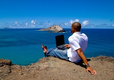 man-laptop-sea